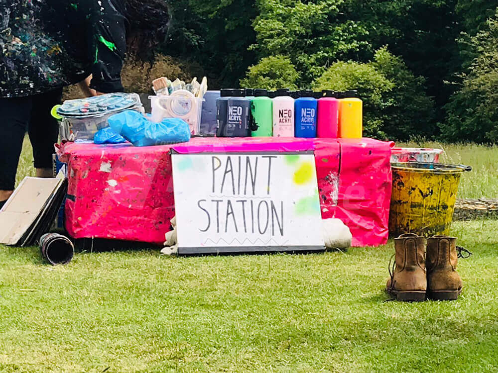 Paint station at art team building event