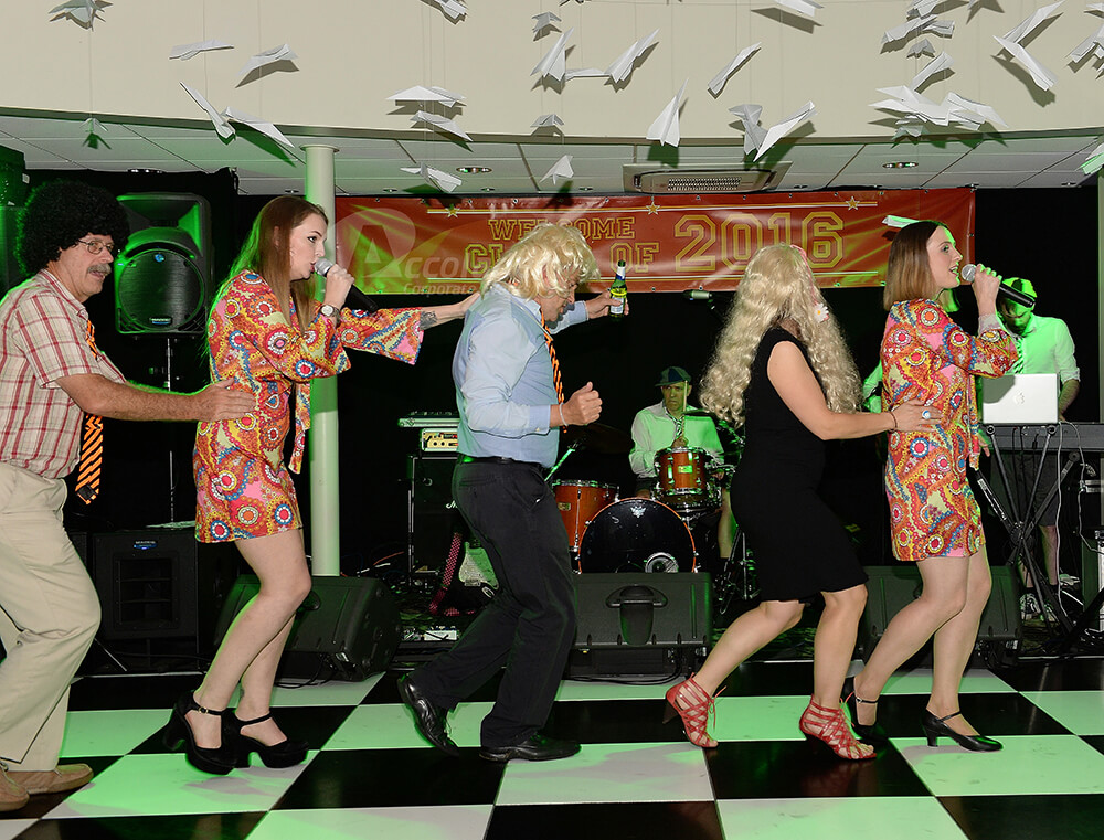 People dancing on a chequered dancefloor Back to School party event