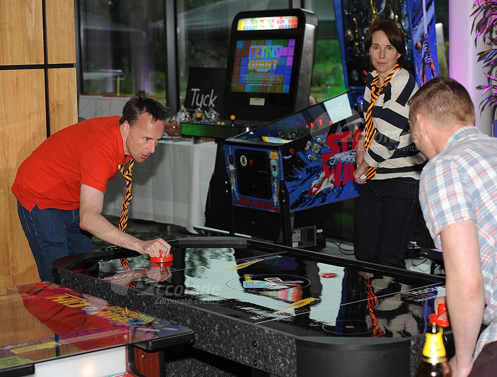 People enjoying retro games at Back to School party event