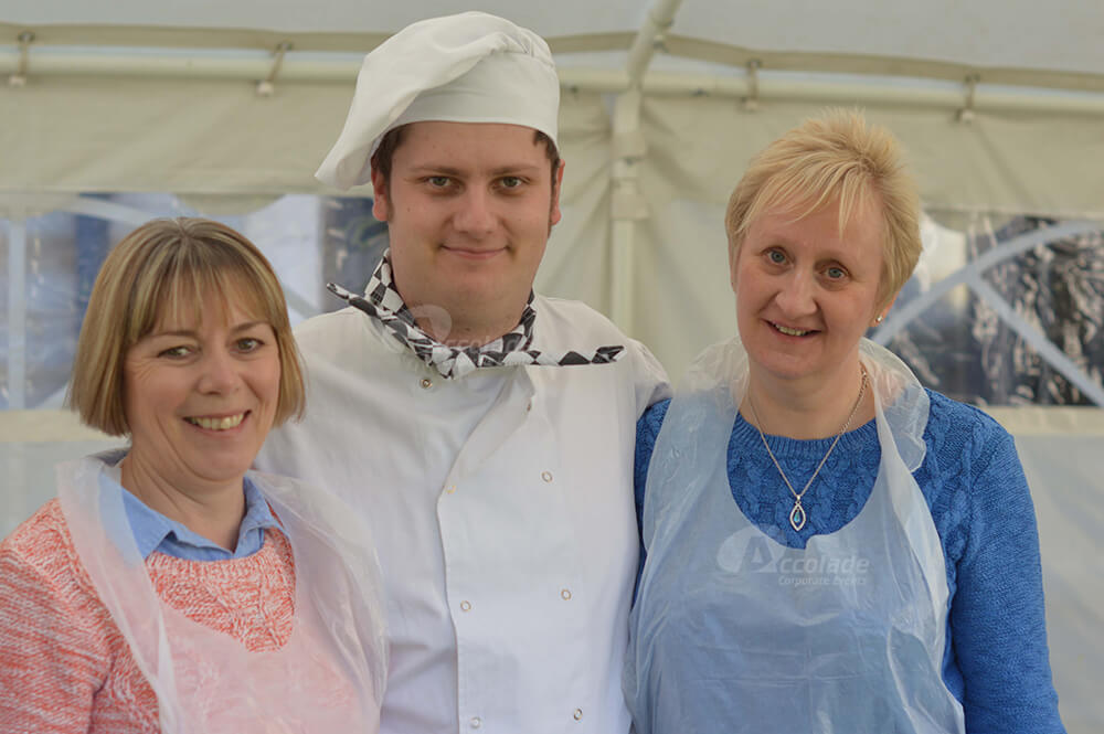 Two ladies with chef at Company Bake Off team building event