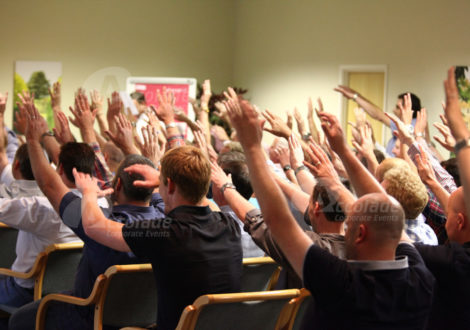 Body percussion energiser with peoples hands in the air