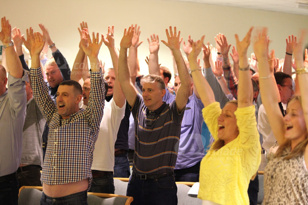 People standing up with hands in the air Body percussion energiser