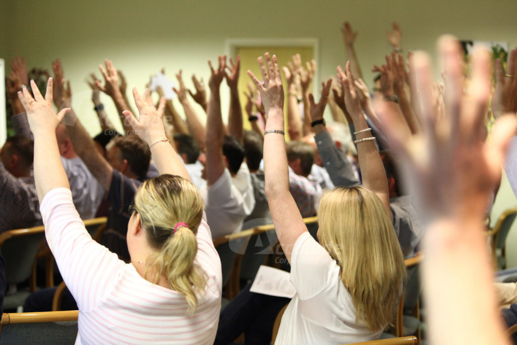 Group raising their arms Body percussion energiser event