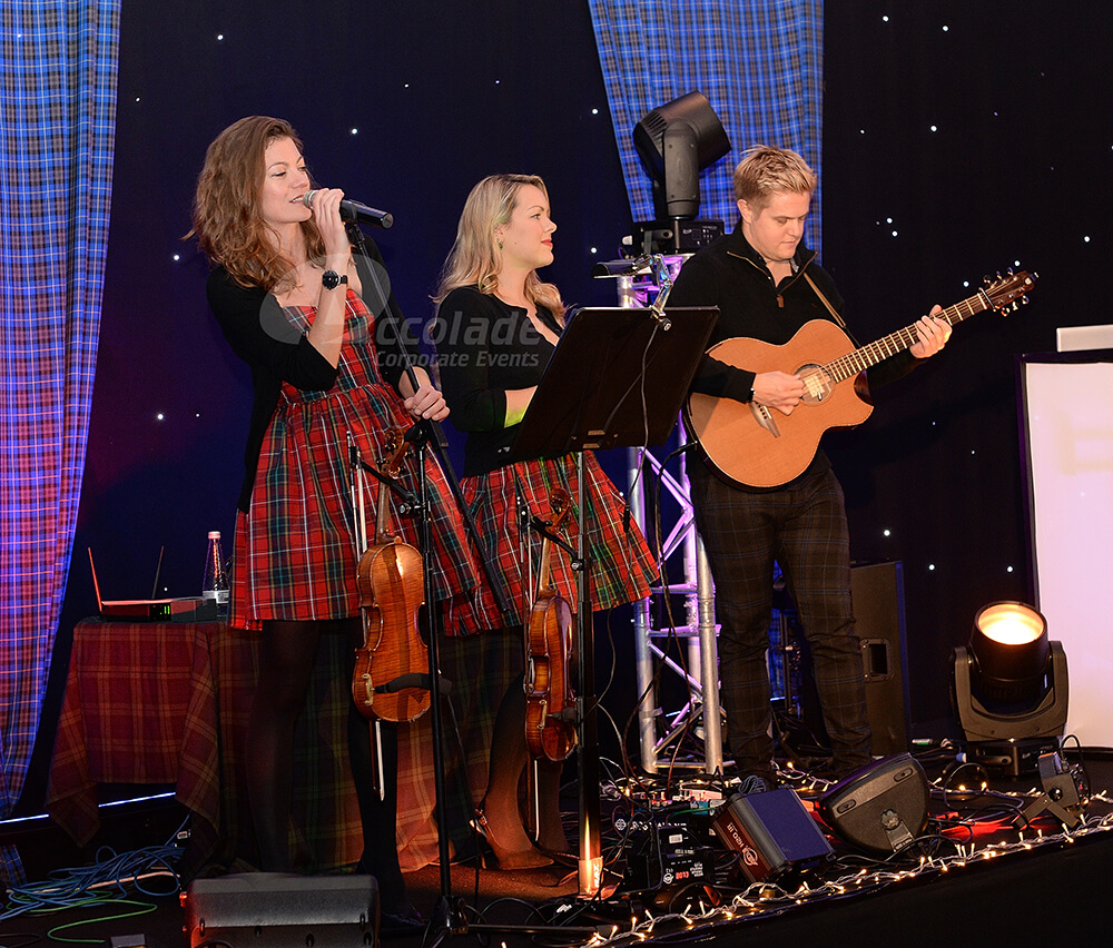 Tartan clad band at a Scottish themed company party