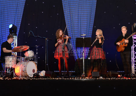 Scottish band on a stage at a Scottish themed company party