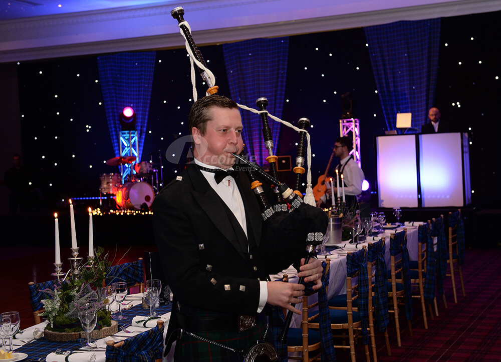 Bagpiper at a Scottish themed company party