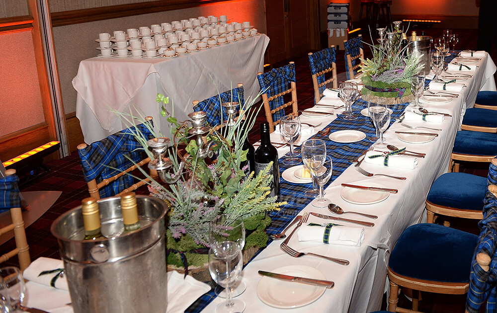 Scottish themed tables ready for dinner at a Scottish themed company party