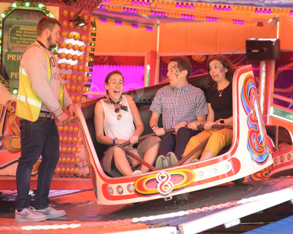 People Riding Waltzers Company Fun Day Event