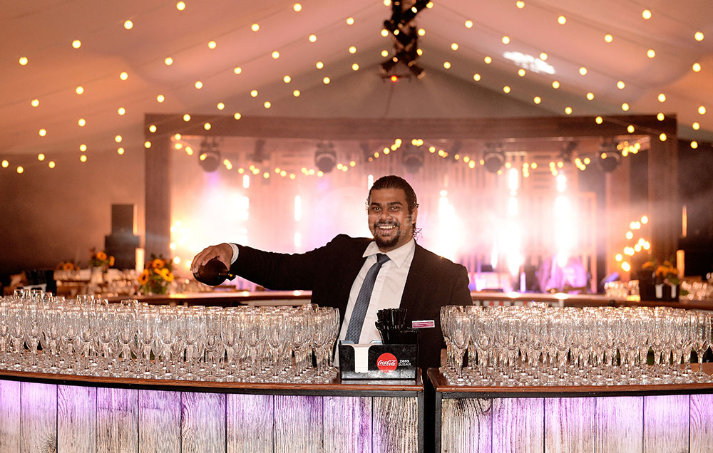 Country Chic Corporate Event Barman Pouring Champagne