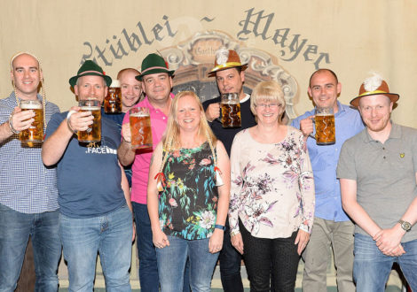 Group in Front of Backdrop German Beer Festival Corporate Event