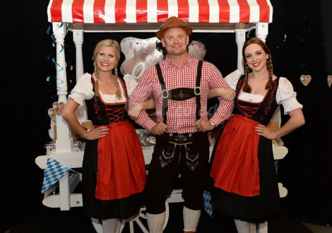 Man in lederhosen and Fraulines and German Beer Festival Event