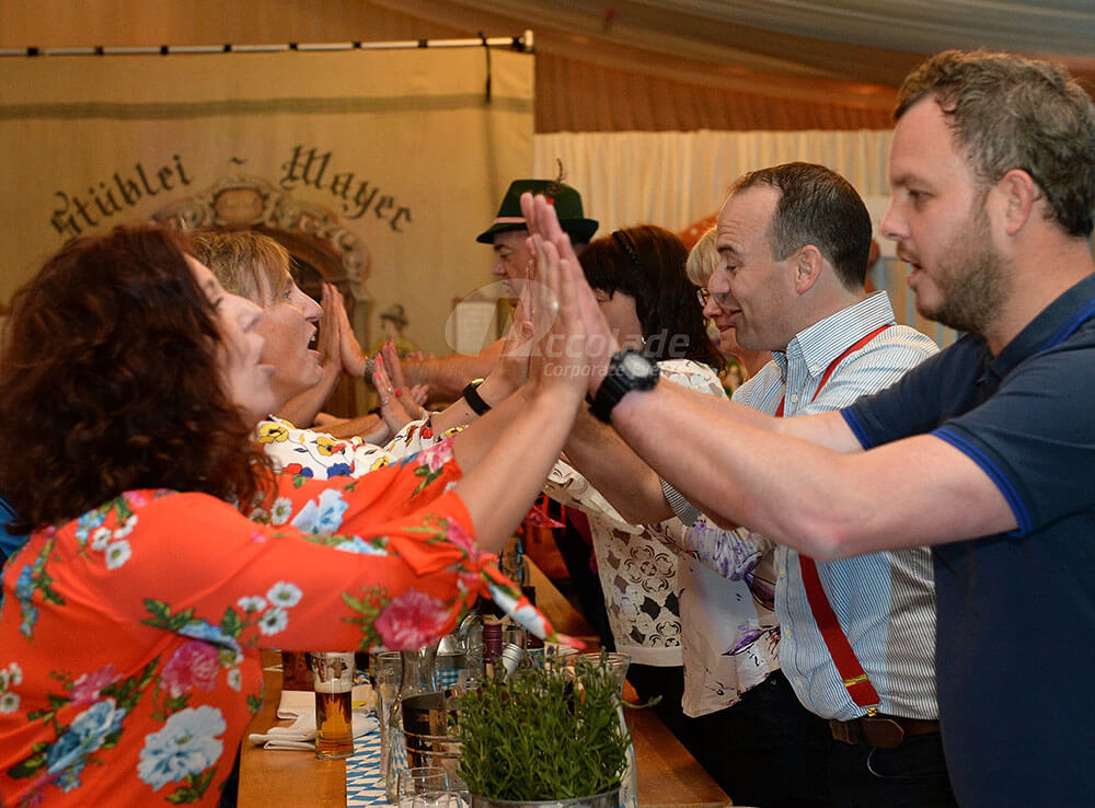 People slapping hands at German Beer Festival event