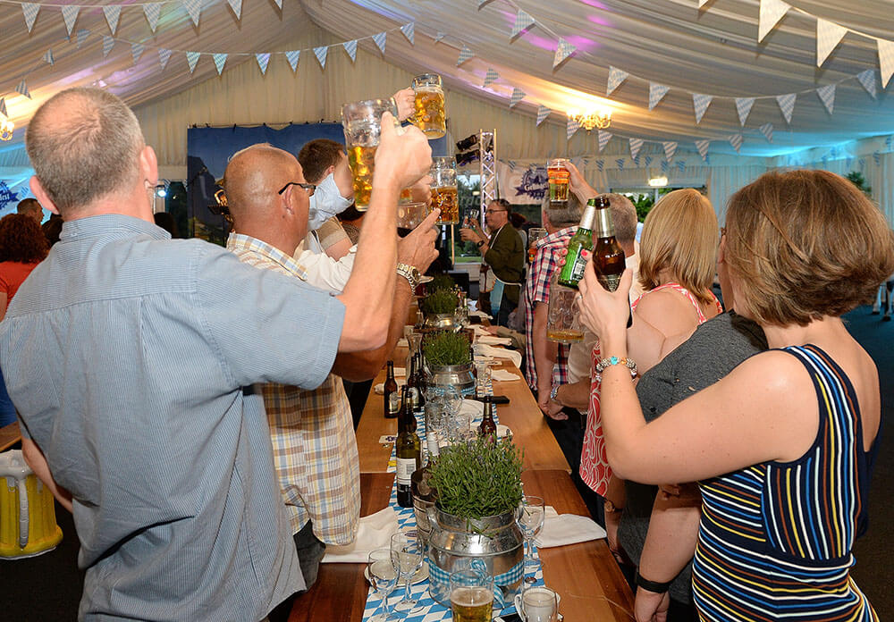 People raising glasses at German Beer Festival event