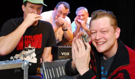 Happy people at harmonica workshop