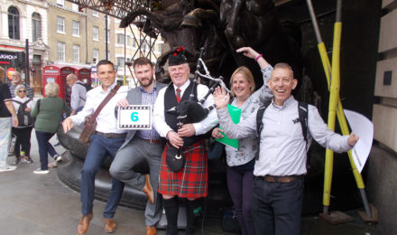 Team with bagpiper on Treasure hunt team building event
