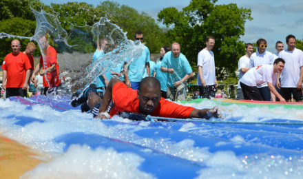 Man on foam filled inflatable its a knockout total wipe out event