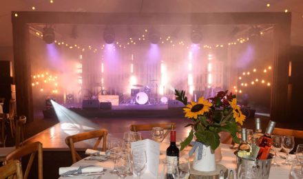 Country Chic Corporate Event Sunflowers with and Stage Lighting