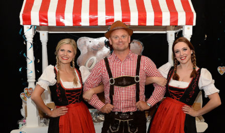 Man and women in costume at German Beer Festival company event