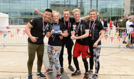 Winning team outside Media City Manchester for It's a Knockout NHS team building event