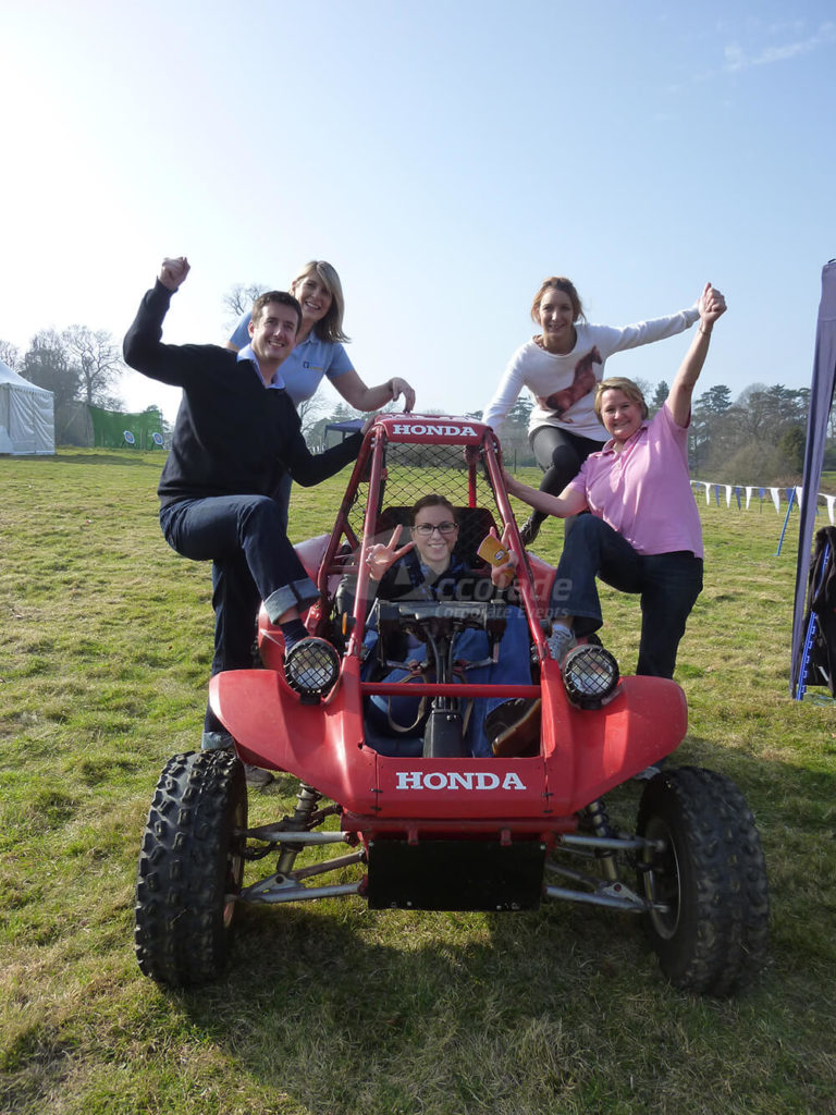 Happy team on a Honda pilot at company away day