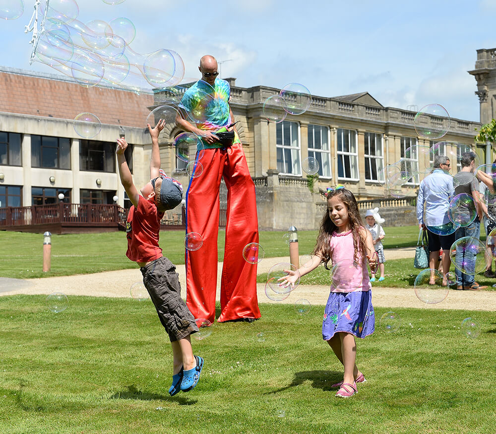 Stilt walker at company fun day