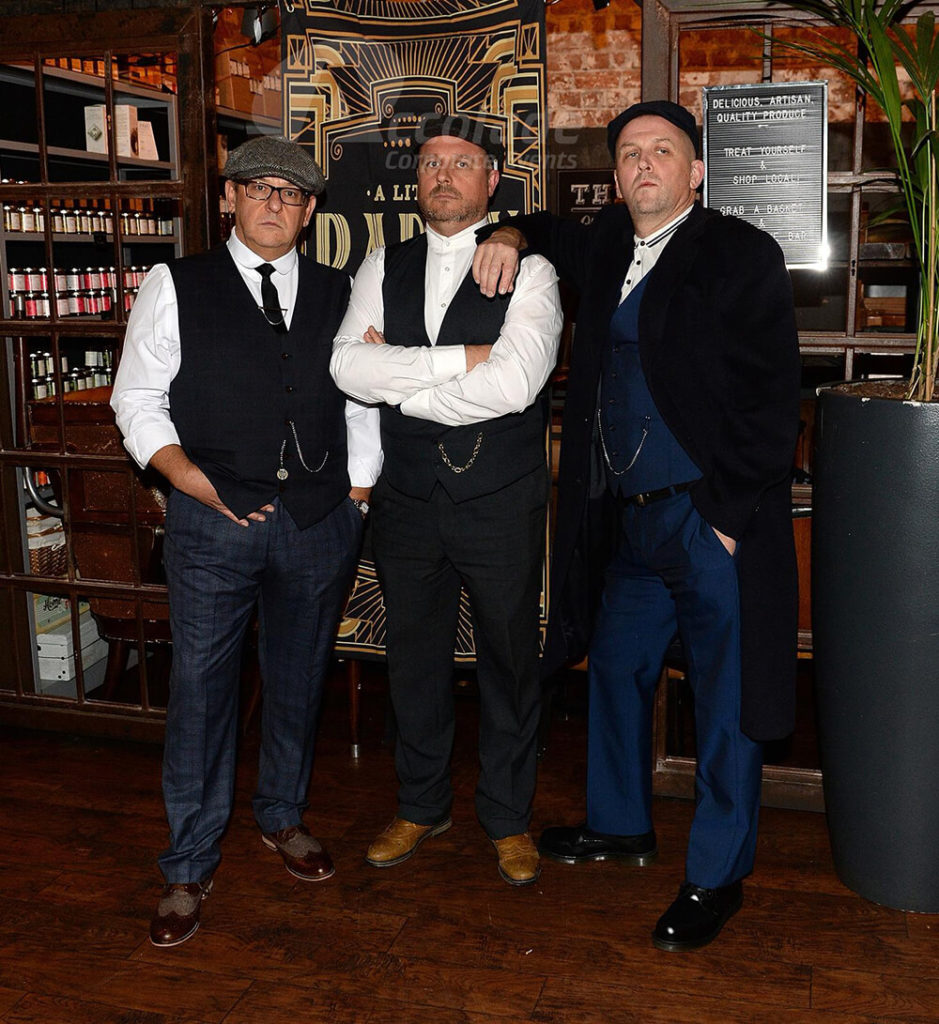 Three men looking tough for a Peaky Blinders Corporate Event