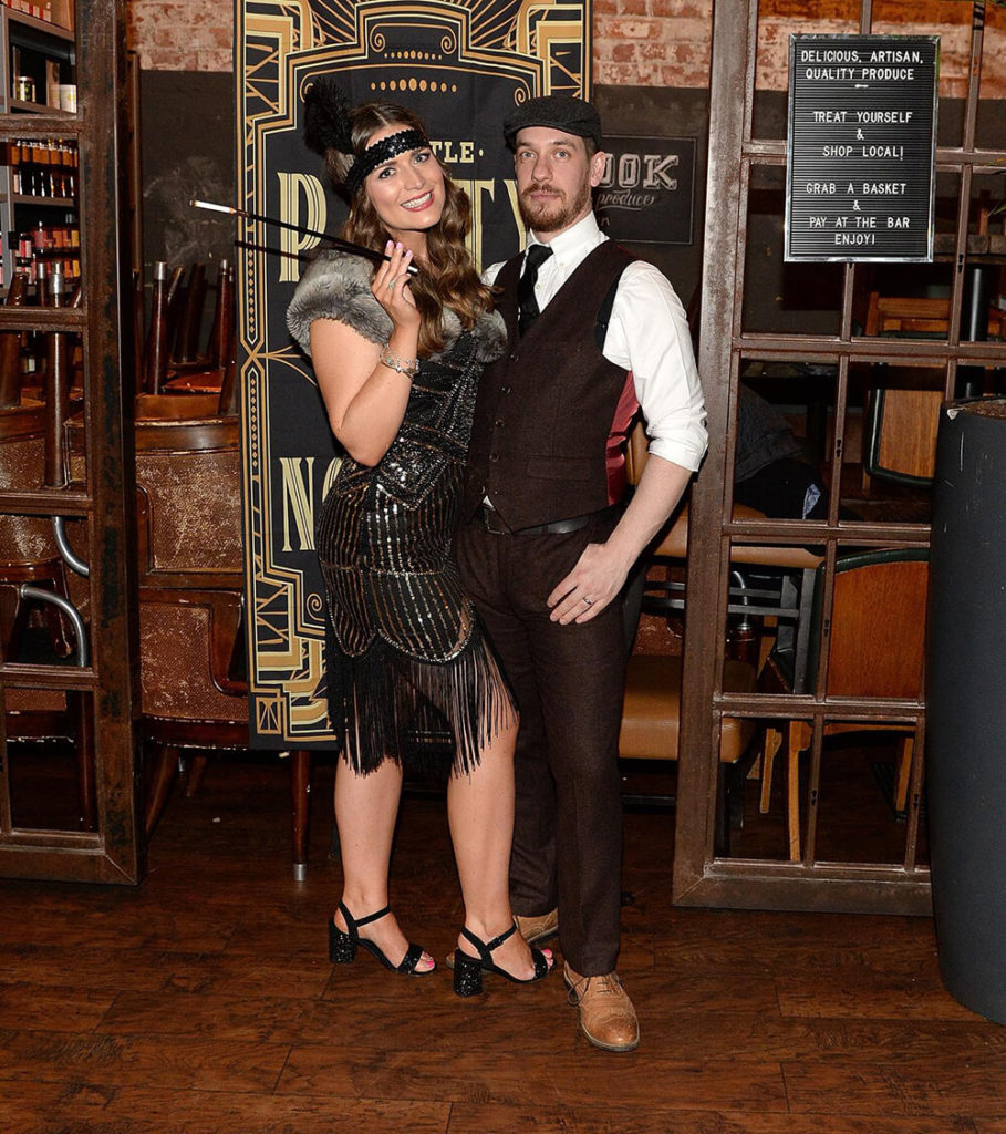 Man and woman ready for a Peaky Blinders Corporate Event
