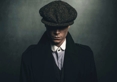 Man dressed as Peaky Blinder in cap for Peaky Blinders party