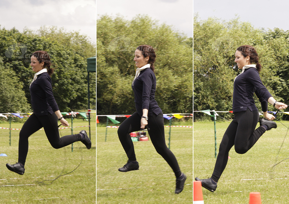 Lady in a skipping race at adults School Sports Day team building event