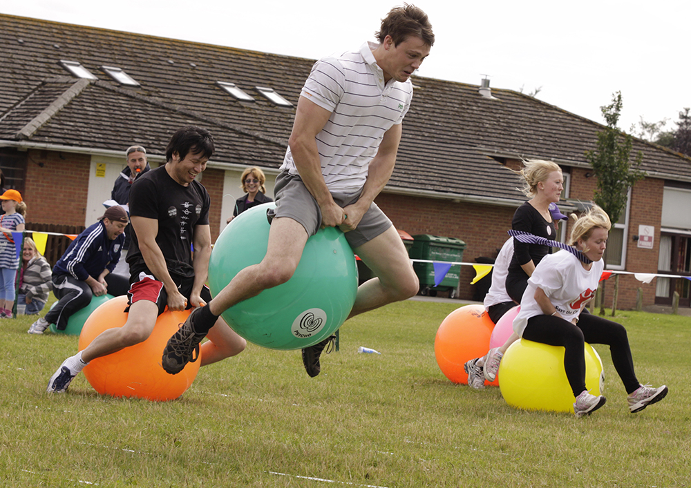 Man on a space hopper at School Sports Day team building