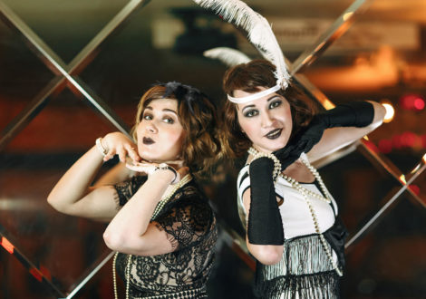 Two ladies at a Speakeasy themed company party