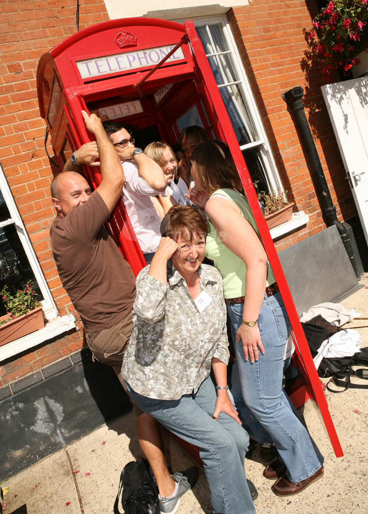 Team Posing By Telephone Box Spooks Team Building Event