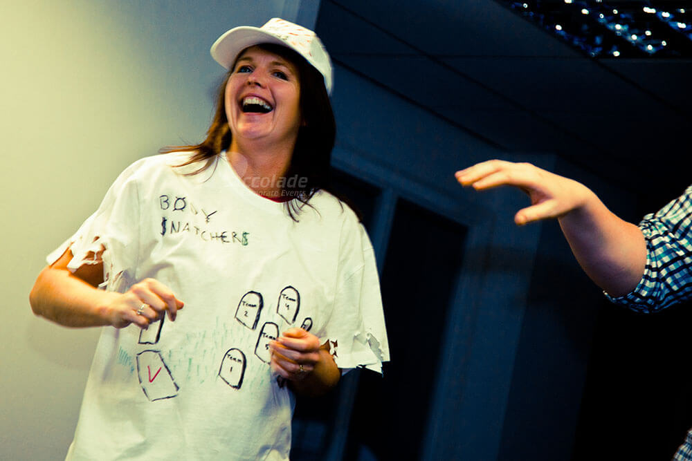 Lady laughing in a t-shirt in Team Apprentice team building event
