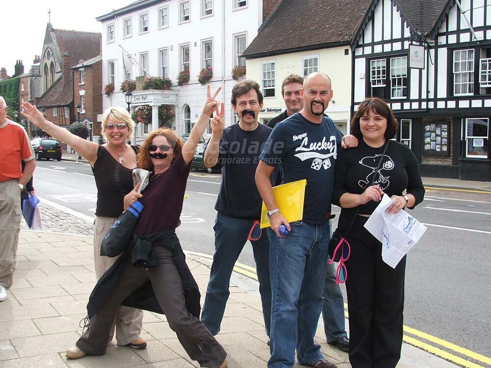 Group with moustaches on Treasure hunt team building event