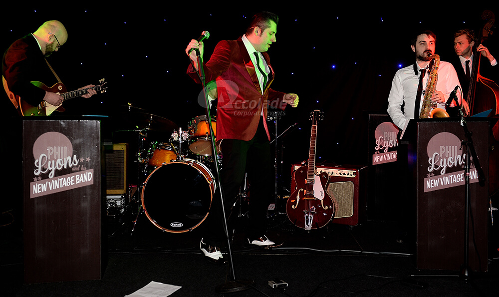 Lead singer on stage at a Viva Las Vegas company party