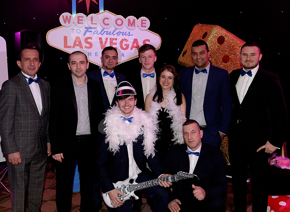 Group posing at a Viva Las Vegas company party