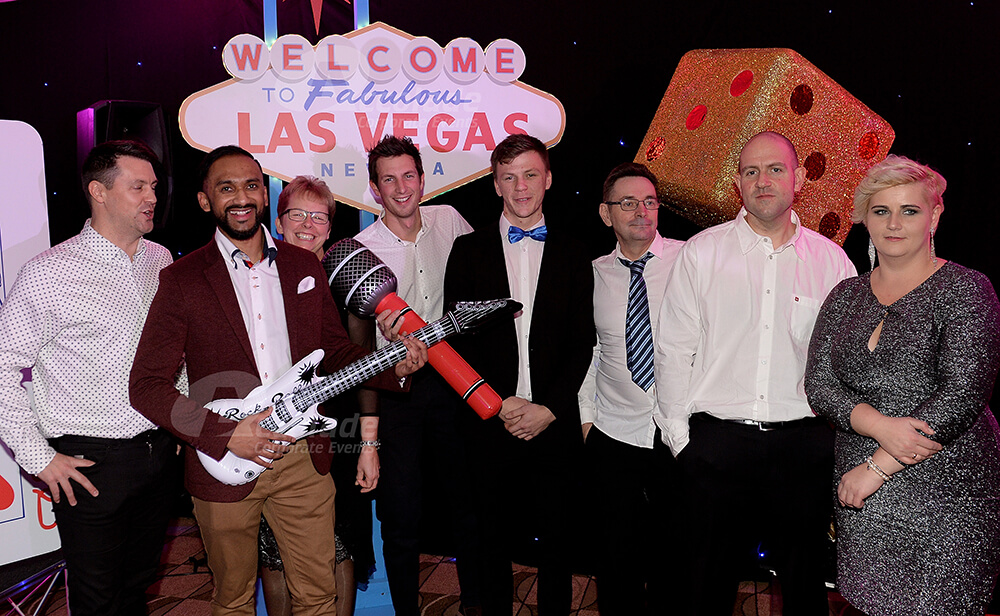 Group with inflatable instruments at a Viva Las Vegas company party