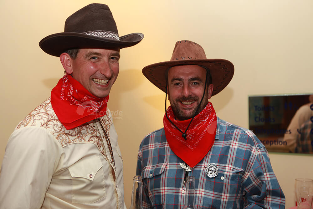 Men Dressed as Cowboys Wild West Party Event