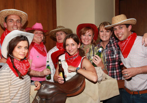 Group Around Saddle Wild West Party Event