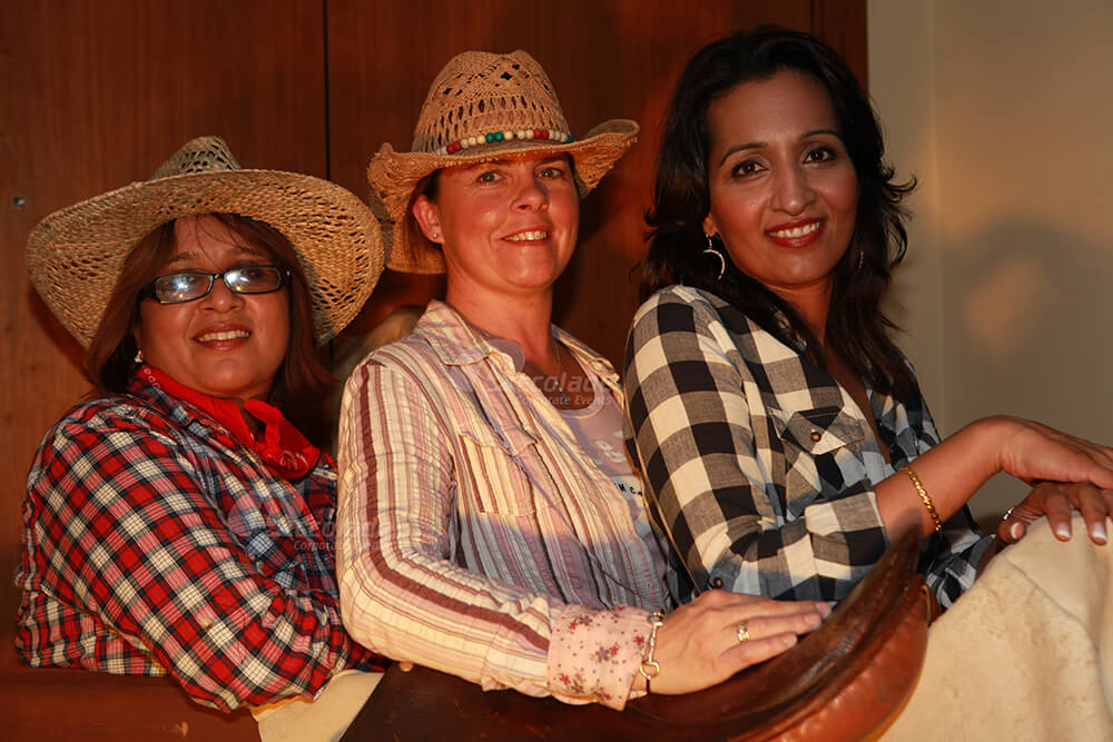 Women Dressed as Cowgirls Wild West Party Event