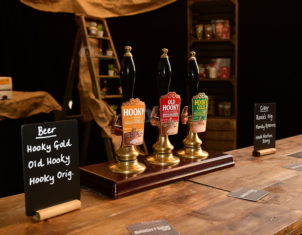 Beer pumps ready for guests at indoor company festival