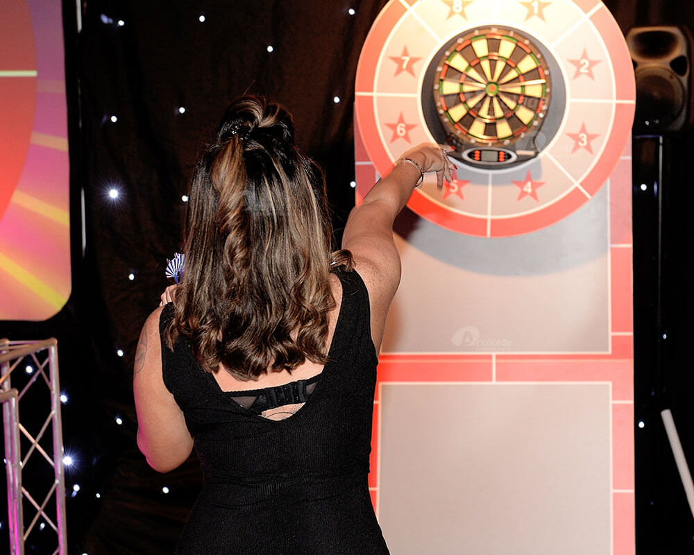 Lady throw dart at corporate event