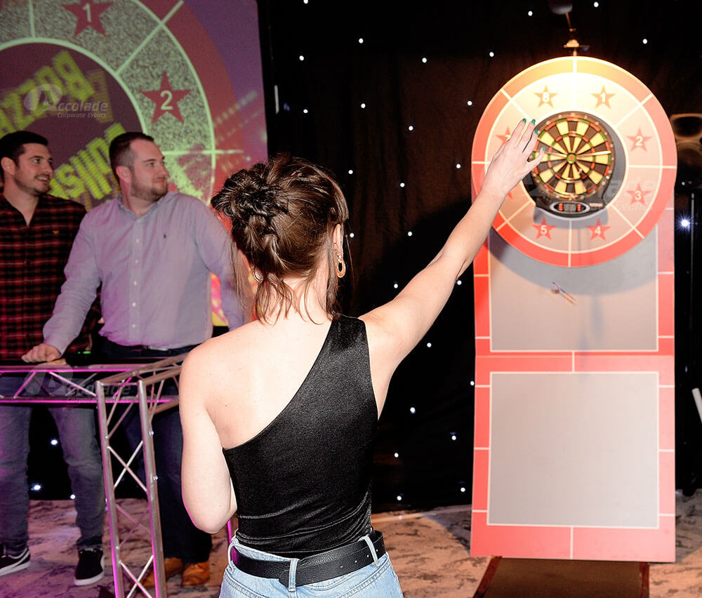 Lady throwing darts at Bullseye corporate event