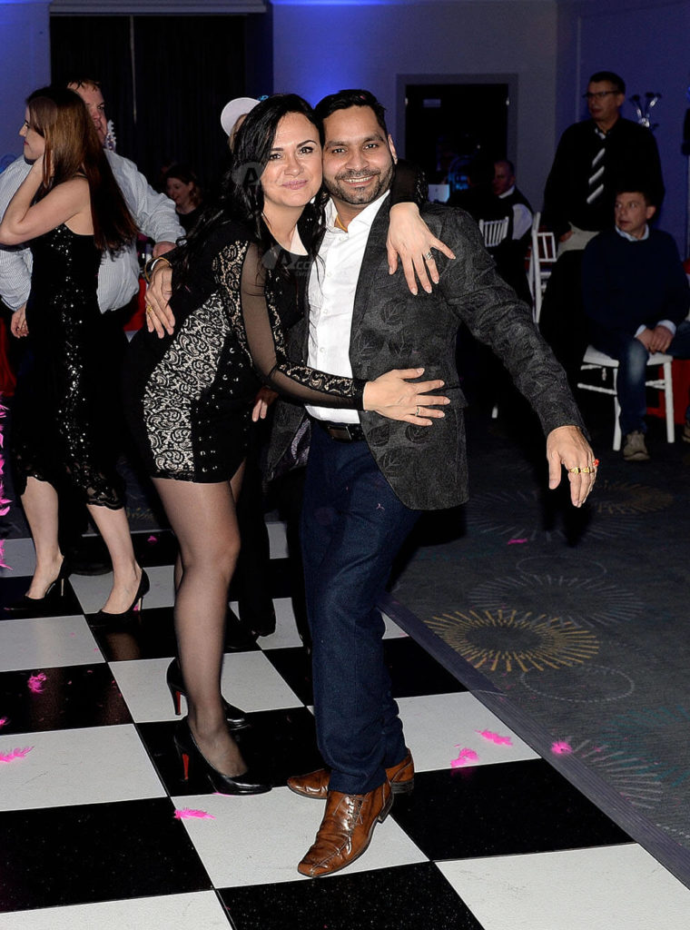 man and woman posing on dancefloor
