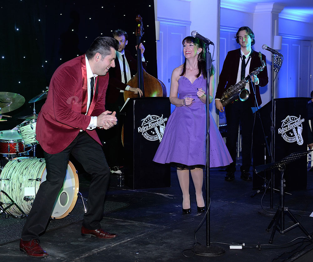 Rock and roll band performing at corporate event