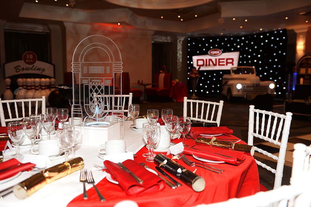 American diner themed party with diner sign, Cadillac and star cloth